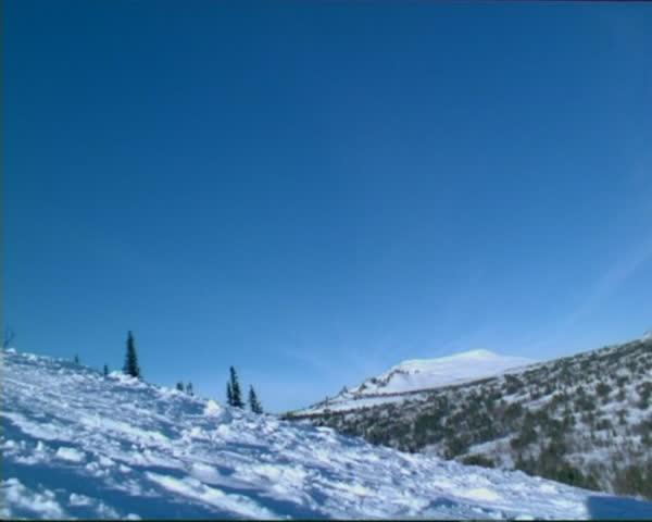 The skier glide near camera, in mountainous Shoria