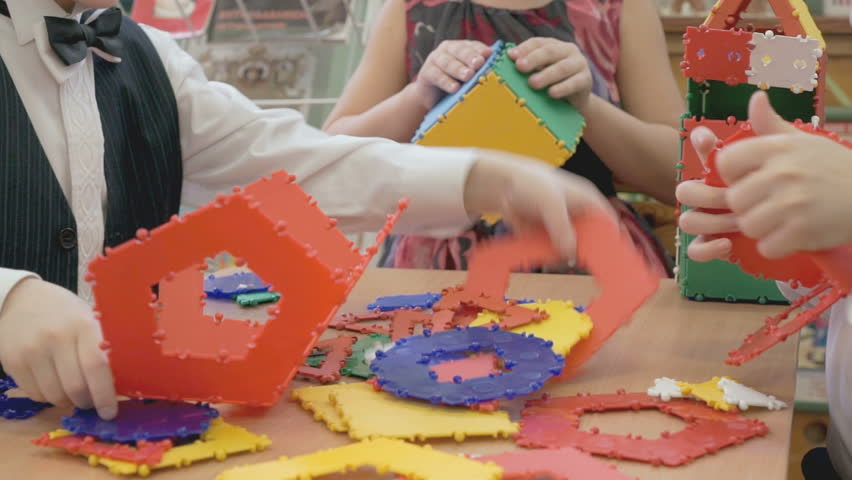 Children play intellectual games at a kindergarten | Shutterstock HD Video #16428436