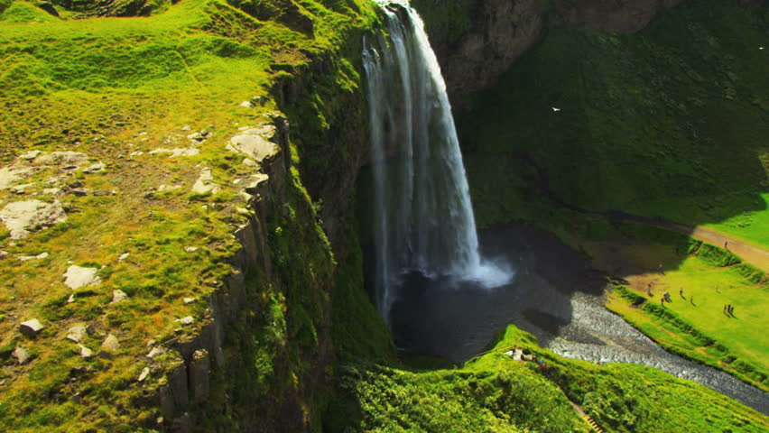 Aerial view of Glacial Meltwater Forming a Waterfall, Iceland | Shutterstock HD Video #1644481