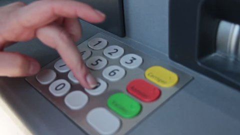 Female Hand Enter Atm Banking Cash Machine Pin Code. A personal identification number is a numeric password used to authenticate a user to a system, in particular in association with an ATM card.