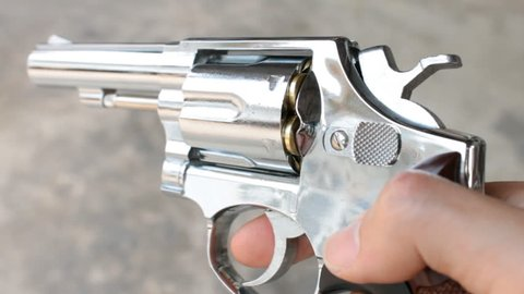 Spinning The Gun or Pistol or Revolver. Human is spinning or rotating the revolver or gun or pistol by hand