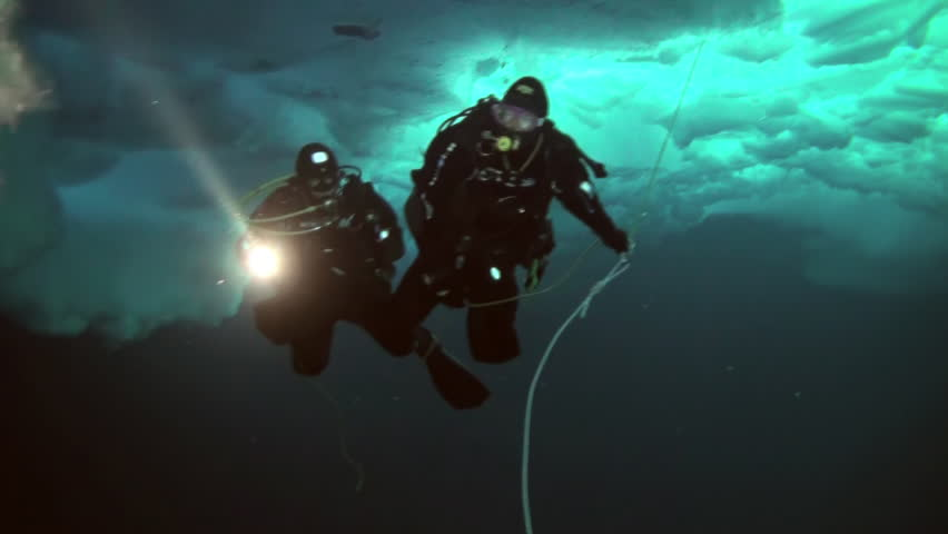 Unique extreme underwater shooting scuba dive beneath ice at geographic  North Pole in cold waters. Fantastic views of the lump of ice in water. ICE CAMP BARNEO, NORTH POLE, ARCTIC - APRIL 10, 2015 | Shutterstock HD Video #16524421