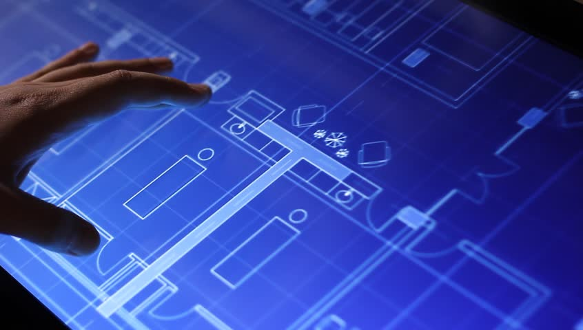 """MOSCOW, RUSSIA, MAY 19, 2015: Architecture blueprint drawing on touch screen computer in """"Design Tech"""" department of the exhibition of modern technology in Moscow."""