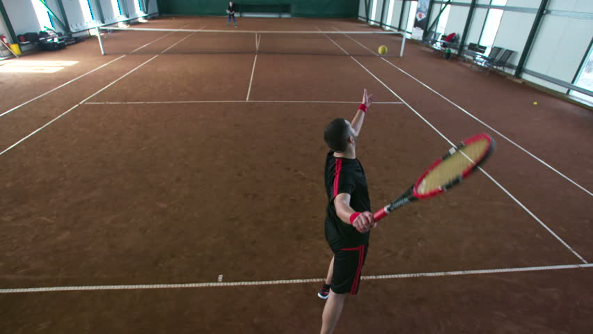 Overhead angle Crane shot of young professional tennis player #16562911