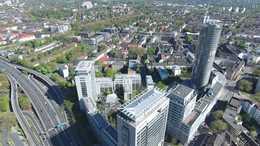 CITY SKYSCRAPER OFFICE BUILDINGS IN ESSEN GERMANY RUHRVALLY INCLUDING THE RWE TOWER CENTRAL STATION HAUPTBAHNHOF STADT RUHRGEBIET ESSEN SUNNY DAY SONNIGER TAG