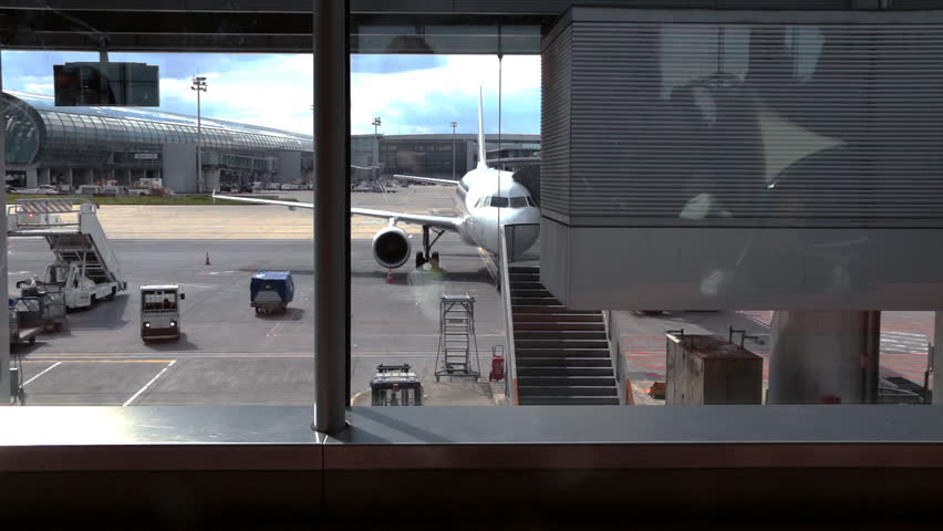 Piece of airport - view from boarding room with reflections. | Shutterstock HD Video #16648861