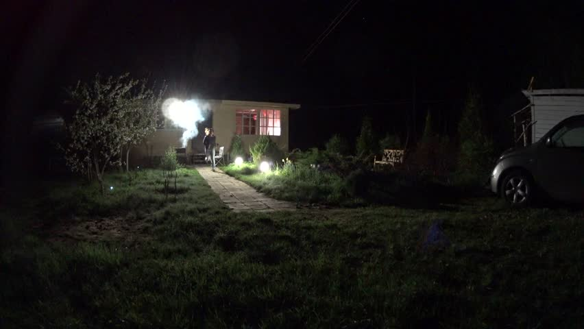 Woman running out the house in garden Darkness  | Shutterstock HD Video #16675321