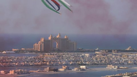 Palm Island  with planes drawing national flag with smoke