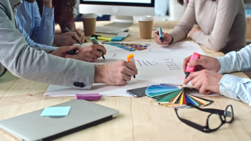 Hands of creative design team brainstorming to generate ideas in meeting, team leader providing instruction, shot on Sony NEX 700 + Odyssey 7Q | Shutterstock HD Video #16740511