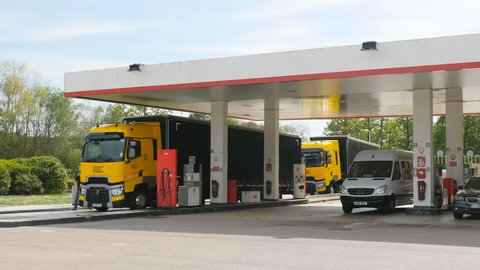 FRANCE - CIRCA 2016: Renault T520 Yellow Truck from the Formula One Sport Team at French gas station