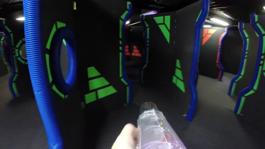 MOSCOW - DEC 13, 2014: (FPV) People in Q-zar of park COSMIC-Capitol (child, woman on 6th second with MR). Q-Zar - laser tag. Refers to arena, high-speed type (rate - up to 6 shots per second)