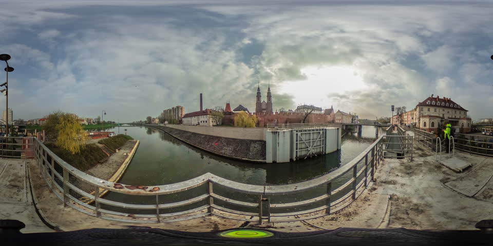 Man With Backpack, Two Towers of a Cathedral, City on a Smooth River, Bridge, Embankment, Houses, vr Video 360, Little Planet Video, Video For Virtual Reality, Time Lapse, Obsolete Buildings, City