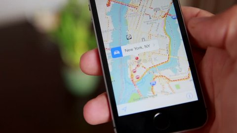 Close-Up Of Hands Using Google Maps In Smart Phone. Man Holds Phone In Hands And Uses Gps