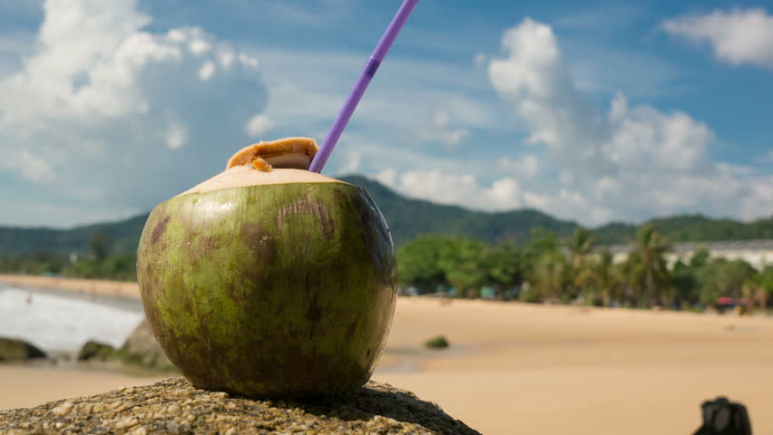 Fresh Coconut With Drinking Straw On Tropical Beach Thailand Karon Time Lapse