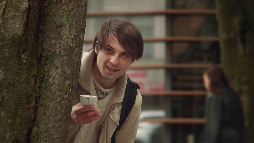 Man Spying Hiding Behind a Tree | Shutterstock HD Video #16791151