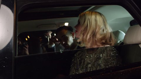 Celebrity couple arriving in limo, photographed by paparazzi, shot on R3D