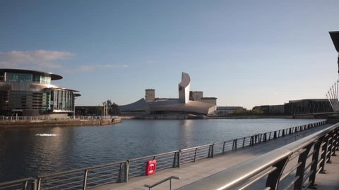 SALFORD QUAYS, UK, MAY 14TH 2016; Pan from Libeskinds 'Imperial war museum north' to theThe Lowry centre theatre and culture complex located in the redeveloped Salford Quays