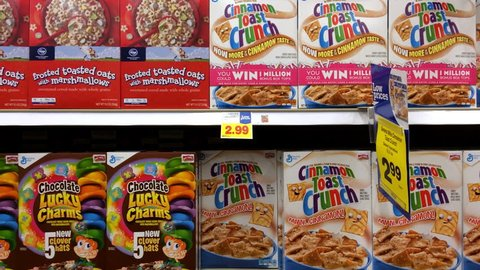 USA - CIRCA 2015: Multiple cereal options at grocery store aisle of Kroger store, displaying an every day breakfast of a child growing up in America.