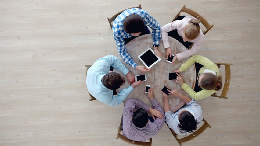 Group of diverse people using digital devices | Shutterstock HD Video #16933138