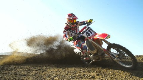 Super Slow Motion Professional Motocross Rider On Dirt Track.