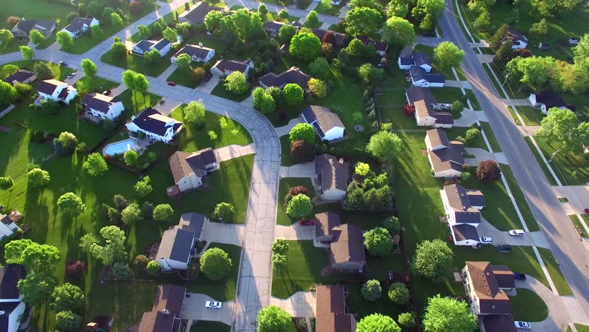 Beautiful, suburbs with stunning houses and landscaped yards, early morning, aerial view.