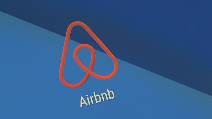 MONTREAL, CANADA - May 2016 : Finger tapping the Airbnb icon to open the application on a smartphone.
