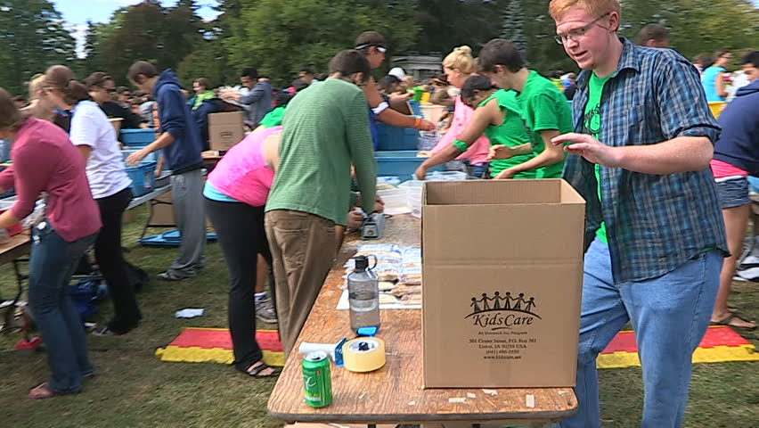 Guelph, Ontario, Canada September 2014 Students Volunteers pack charity food aid for homeless and starving in Africa