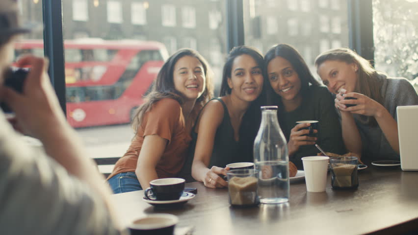 4K Happy group of female friends pose for photo in city coffee shop UK - April, 2016