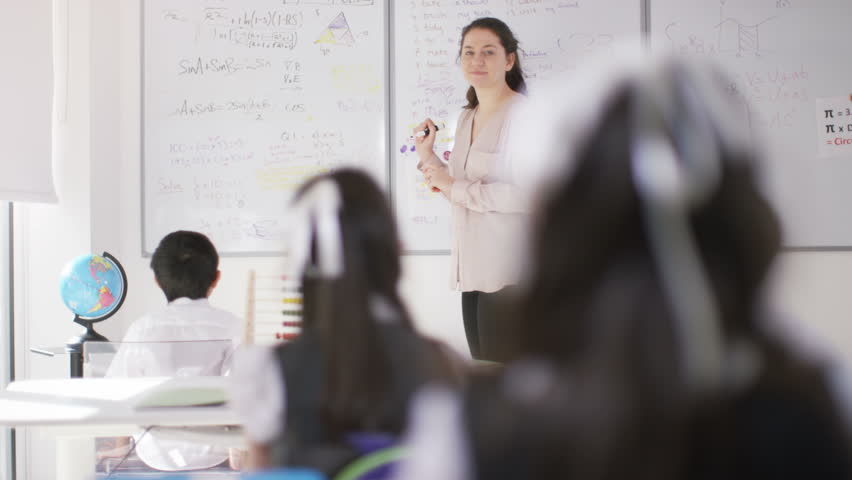 4K Happy school children in class listening to teacher & answering questions UK - April, 2016   Shutterstock HD Video #16996351