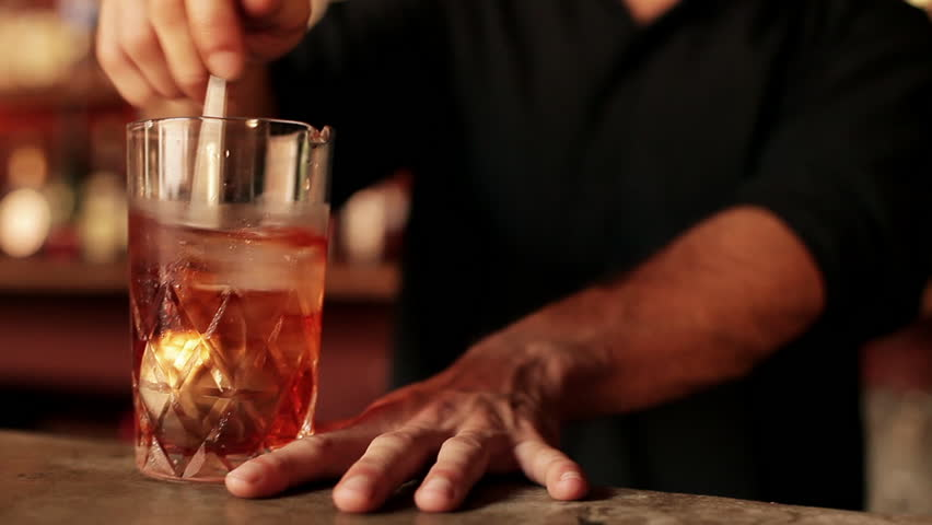 Buenos Aires, Argentina - January 22, 2013: Bartender stirring negroni in glass