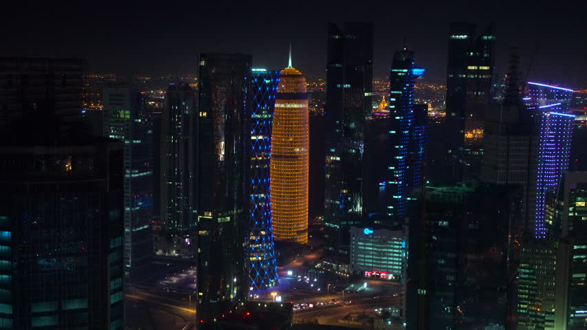 Doha, Qatar - February 2016: Night & illuminated skyline over downtown & central business district, Doha, Qatar, Middle East | Shutterstock HD Video #17034751