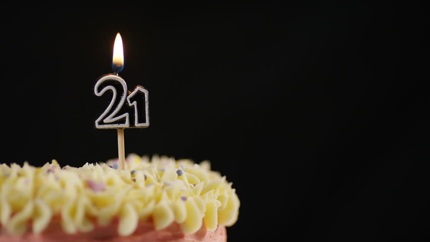 4K Candle For A 21st Celebration Cake Being Blown Out In Slow Motion Space Text