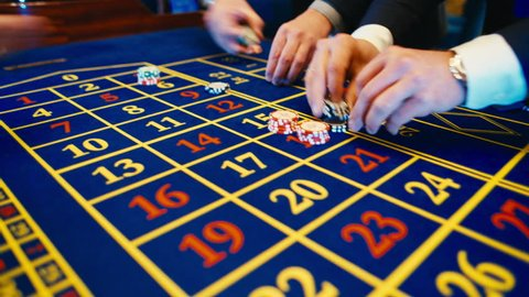 Betting chips - Casino Roulette People playing Roulette in a Casino,