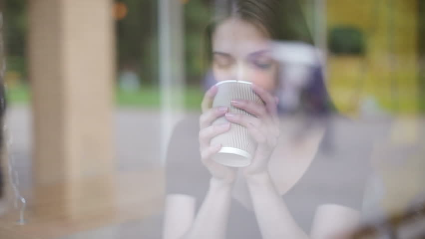Woman drinking coffee in restaurant or cafe #17089228