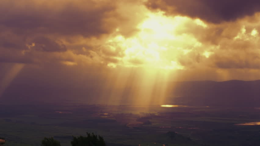 Beautiful, static shot of the sun streaked valley visage, sunbeams coming through the clouds, taken from Nimrod Fortress in the Golan Heights, Israel.  02/21/2011