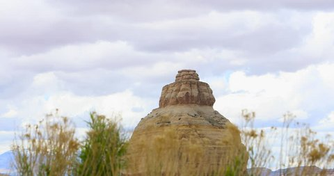 Monticello Utah red sandstone rock formation in rain. Church Rock is a solitary column of sandstone in southern Utah near the entrance to the Needles District of Canyonlands National Park.