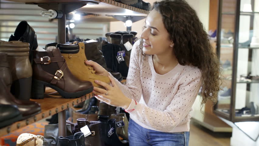 f6345c7ed8f Female Buying Winter Womens Shoes Stock Footage Video (100% Royalty-free)  17115661 | Shutterstock