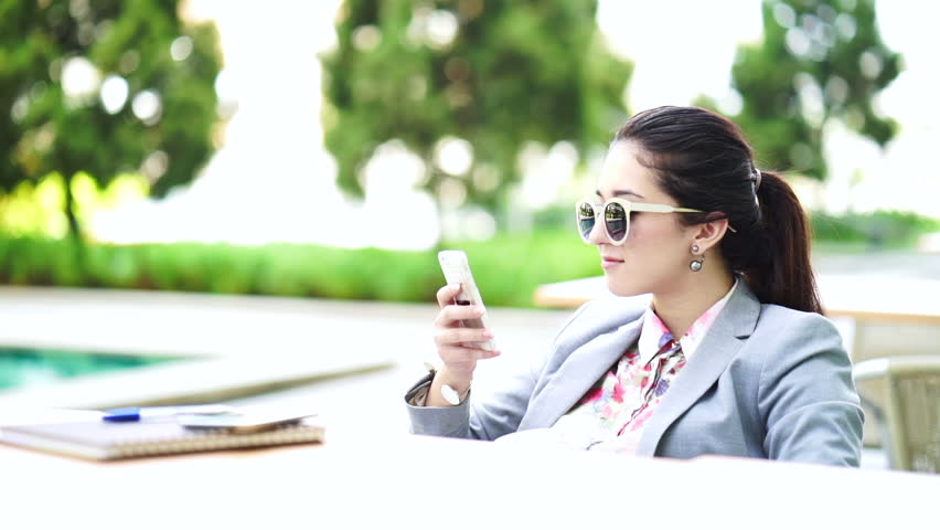 Communication and technology concept - elegant and beauty woman texting on cell phone and drinking coffee | Shutterstock HD Video #17118061