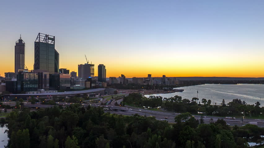 Time lapse Footage of beautiful dramatic Sunrise At Perth City, Australia With Zoom Out Effect during summer. Taken from Kings Park And Botanic Garden. Showing a clear sun rise from the horizon line.