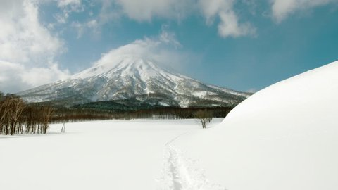 Mt Yotei - Scenic Shot in the Middle of Winter. Sunny Snow Covered Hiking Path at the Bottom of the Tallest Mountain Volcano in Niseko, Hokkaido, Japan