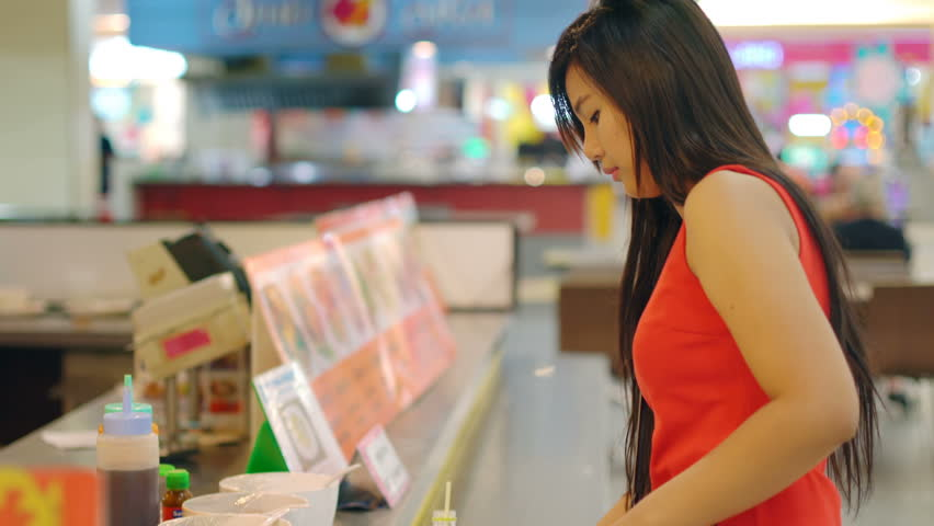 Young Asian Lady taking food in foodcourt 4k UHD (3840x2160)  | Shutterstock HD Video #17144074