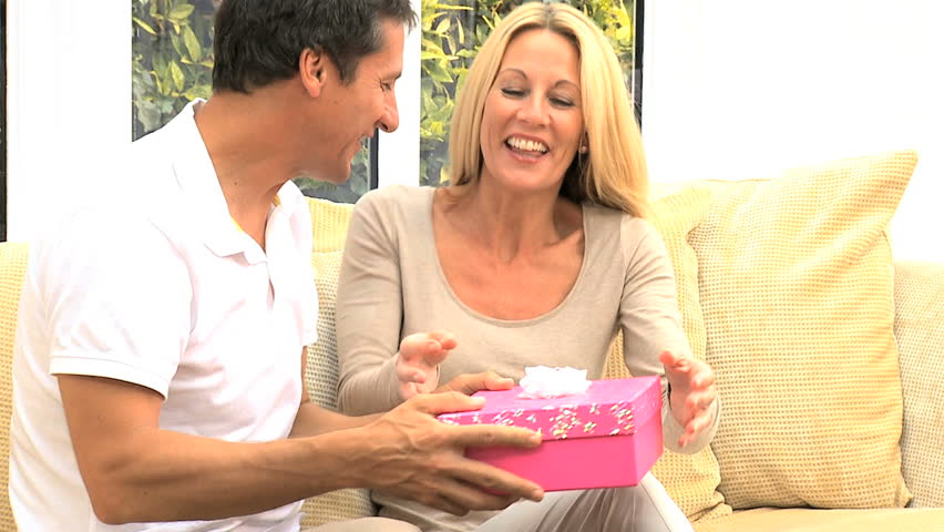 Caucasian Female Receiving Birthday Gift From Husband