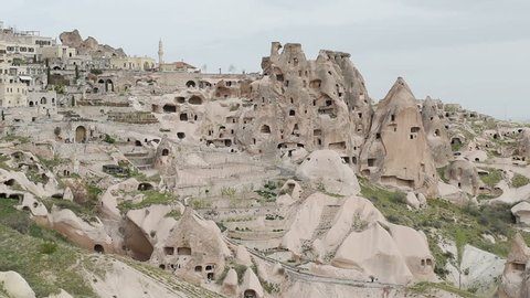 Flying balloons over Cappadocia Turkey. Cappadocia, with its valleys, gorges, hills, located between the volcanic mountains in Goreme National Park.