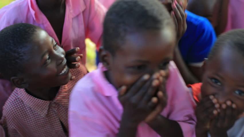 KENYA, AFRICA - CIRCA 2011: Children playing near a village in Kenya two hours