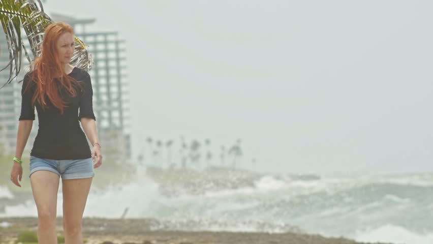 Young attractive woman with long red hair walking along the storm sea, slow-motion | Shutterstock HD Video #17287771