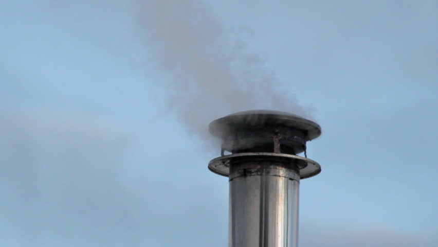 Smoke Pouring Out Of A Chimney Cap On A Metal Stove Pipe From A Wood Fire.  Stock Footage Video 1728781 | Shutterstock - Smoke Pouring Out Of A Chimney Cap On A Metal Stove Pipe From A