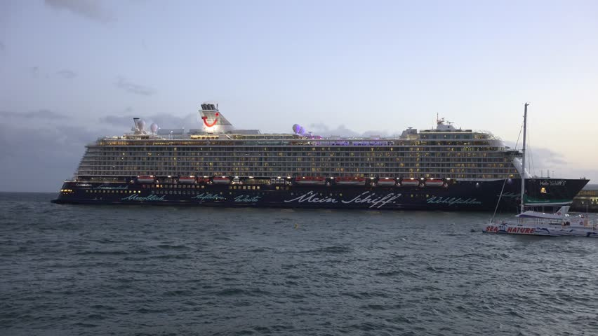 Madeira, Funchal, 1 Jan. 2015, 4k UHD Cruise ships at the dock, Mein Schiff TUI, catamaran and boats in Funchal harbor with city lights /  Funchal harbor cruise ships and boats sunset panning