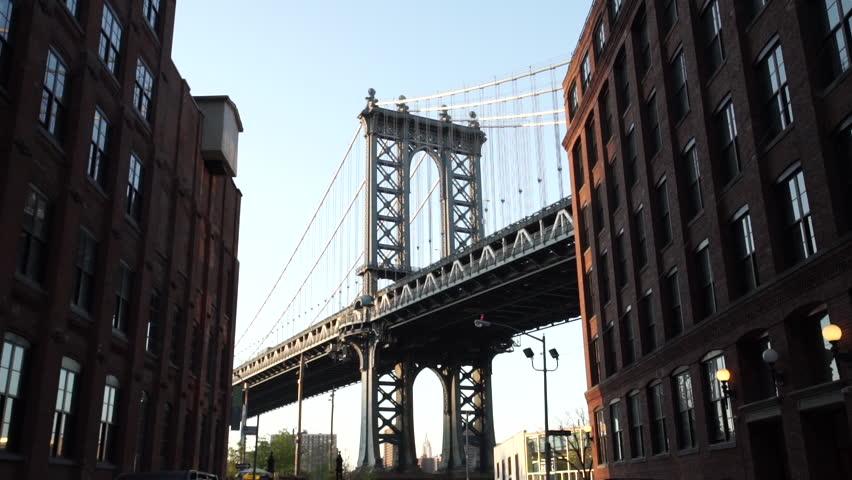 An iconic establishing shot of DUMBO and the Manhattan Bridge riding down Washington Street in Brooklyn. New York - April 1, 2016