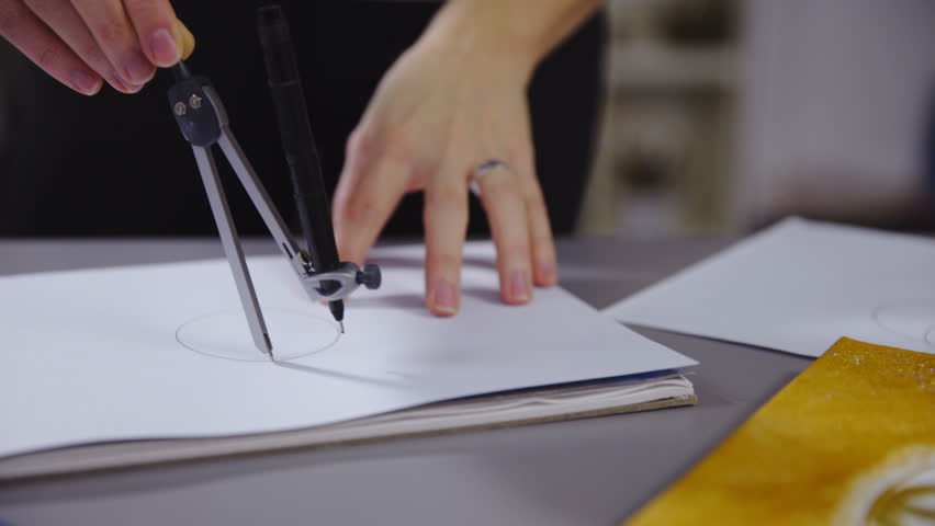 Stock video of drawing circles with compass on paper | 17371261 ...