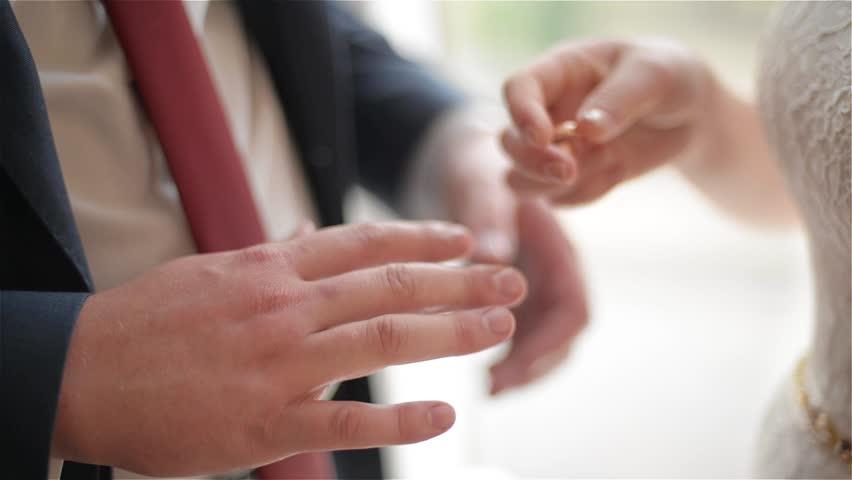 Stock Video Clip of Groom and bride exchange wedding rings